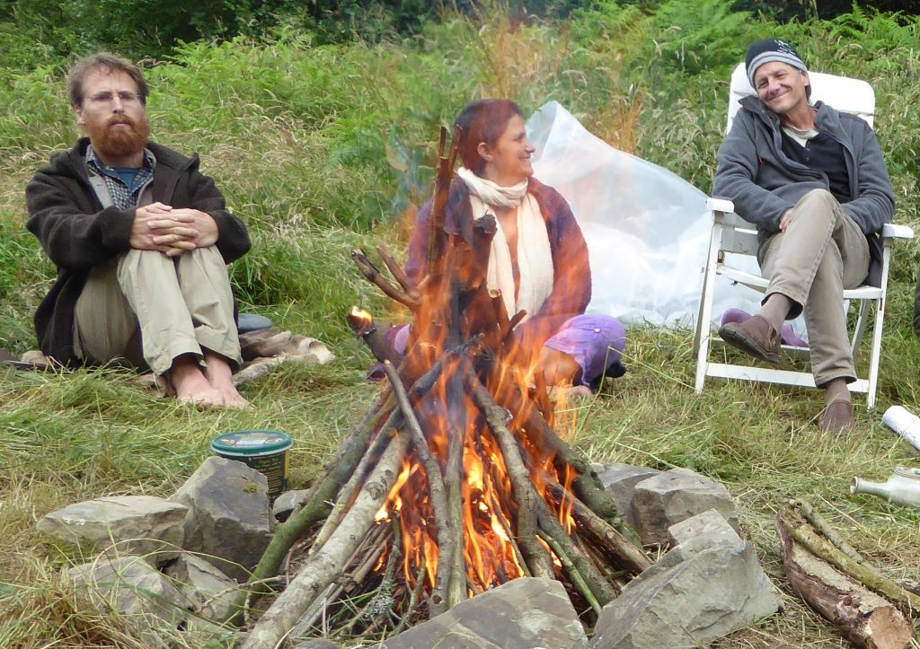 Looby, Jon Young and Pete McCowenround the fire